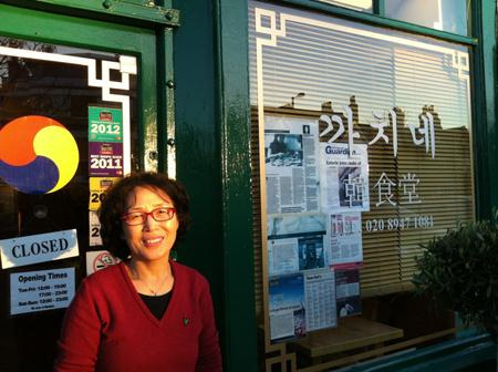 Hyeon-ja Jo, a 25-year resident of the U.K., stands outside her restaurant Cah Chi in the Raynes Park area of Greater London. (Photos courtesy of Niels Footman)
