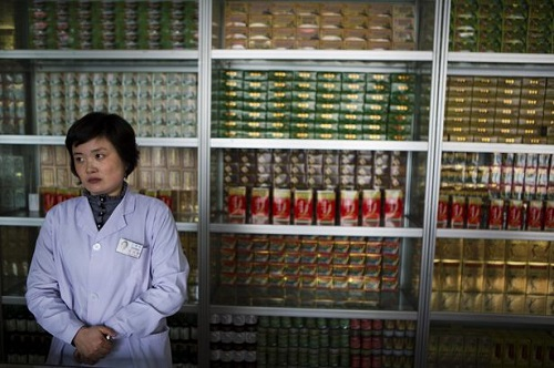 """In this Feb. 21, 2013 photo, a pharmacist waits for customers at the Man Nyon Pharmacy, the nation's largest dispensary of traditional """"Koryo"""" medicine, in Pyongyang, North Korea. North Korea began marrying traditional medicine with modern practice in the 1950s after the Korean War. (AP Photo/David Guttenfelder)"""