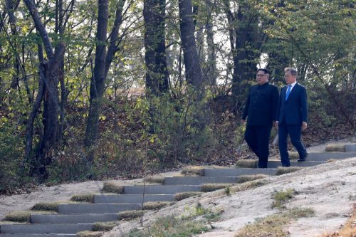 Mr. Kim and President Moon Jae-in of South Korea walking at the border village of Panmunjom in the Demilitarized Zone in April